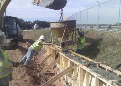 airport concrete fence