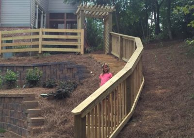 ranch rail with little girl in picture down stairs