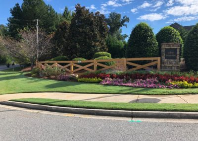 entrance to neighborhood with decorative ranch rail fence